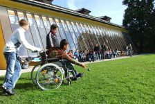 boy in wheelchair playing